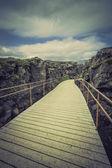 Wooden empty bridge path in Iceland mountains — Photo