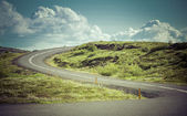 Curved asphalt road in high mountains of Iceland — Stock Photo