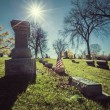 Old cemetery - vintage look with sun light — Stock Photo #57040389
