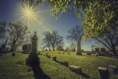 Old cemetery - vintage look with sun light — Stock Photo