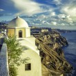 Traditional church on the cliff in Fira, Santorini Island in Greece — Stock Photo #57282517