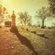 Old cemetery - vintage look with sun light — Stock Photo #57282613