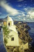 Traditional church on the cliff in Fira, Santorini Island in Greece — Stockfoto