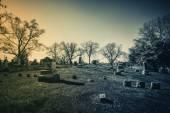 Old cemetery - vintage look with sun light — Stockfoto
