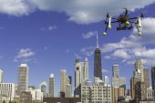 Drone flying above residential skyscraper — Stock Photo