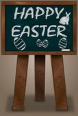 Chalkboard standing on three legs with the words Happy Easter. — Stock Vector