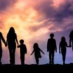 Caucasian family outdoor at sunset — Stock Photo #76108119