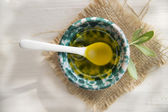 Small container with extra virgin olive oil  — Stock Photo