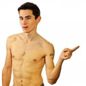 A man with naked body points aside — Stock Photo