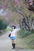 Asian schoolgirl with nature — Stock Photo