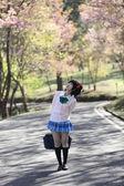 Asian schoolgirl with nature — Stock Photo