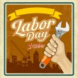 Work tools construction in human hand in Labor day — Stock Vector #77483872