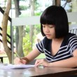 Young girl doing homework. — Stock Video #56959341