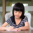 Young girl doing homework. — Stock Video #56961179