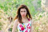 Portrait of woman on meadow, model is a asian girl. — Stock Photo