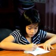 Young girl writing homework. — Stock Video #63628915