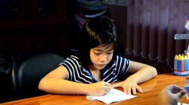 Young girl writing homework. — Stock Video