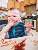 Grumpy Child Eats breakfast — Stock Photo
