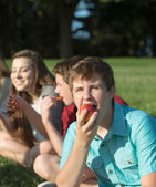 Hungry Teen Eating Apple — Stock Photo