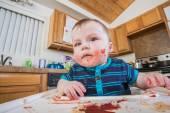 Messy Child Eats breakfast — Stock Photo