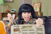 Lady Adjusting TV Antenna — Stock Photo