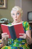 Startled Woman Reading a Book — Stock Photo