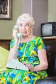 Cringing woman talking on Phone — Stock Photo