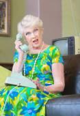 Angry Senior Woman talking on Phone — Stock Photo