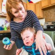 Woman Feeds Gumpy Baby — Stock Photo #59297837