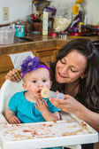 Woman Feeds Baby — Stock Photo