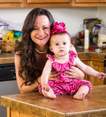 Woman and Baby in Kitchen — Stock Photo