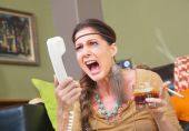 Angry smoker yelling into telephone — Stock Photo