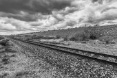Dramatic Clouds and Empty Rails in Desert — Stock Photo