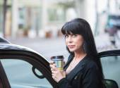 Beautiful Woman Downtown with Coffee — Stock Photo