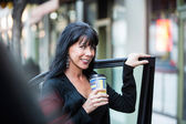 Woman Near Car with Coffee — Stock Photo