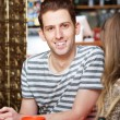 Handsome Man Sitting with Friend — Stock Photo #76284121