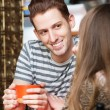 Smiling Man with Friend in Cafe — Stock Photo #76284203