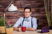 Confident Female in Bowtie with Mug — Stock Photo