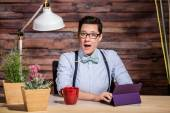Excited Woman at Desk with Tablet — Stock Photo