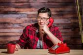 Frowning Woman on Red Phone — Stock Photo