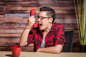 Young Woman Screams Into Phone — Stock Photo