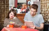 Young Couple at Table with Devices — Stock Photo