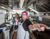Chef Directs Crew on Food Truck — Stock Photo