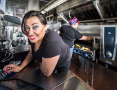 Cashier with blue eyes on food truck — Stock Photo