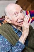 Elderly man sharing a secret — Stock Photo
