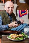Gentleman looking unhappily at sandwich — Stock Photo