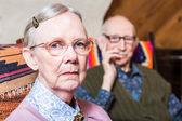 Elderly couple looking serious — Stock Photo