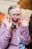 Old woman with hands up gesture — Stock Photo