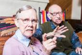 Angry old man and woman scowling — Stock Photo