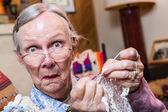 Elderly woman crocheting — Stock Photo